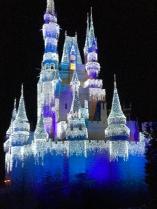 Cinderella's Castle lit up like Elsa's Frozen Castle