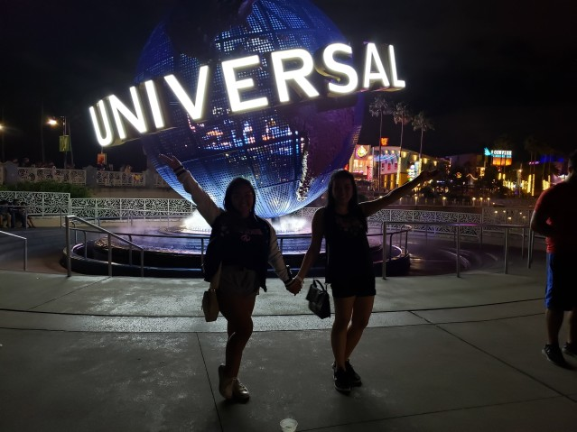 My friend and I standing in front of the Universal logo together.