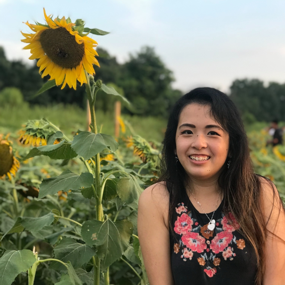 A photo of me in a sunflower field in North Carolina.