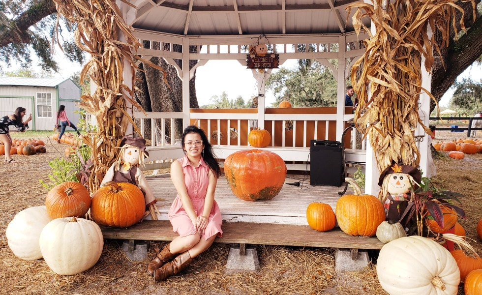Me sitting in a gazebo with some pumpkins.