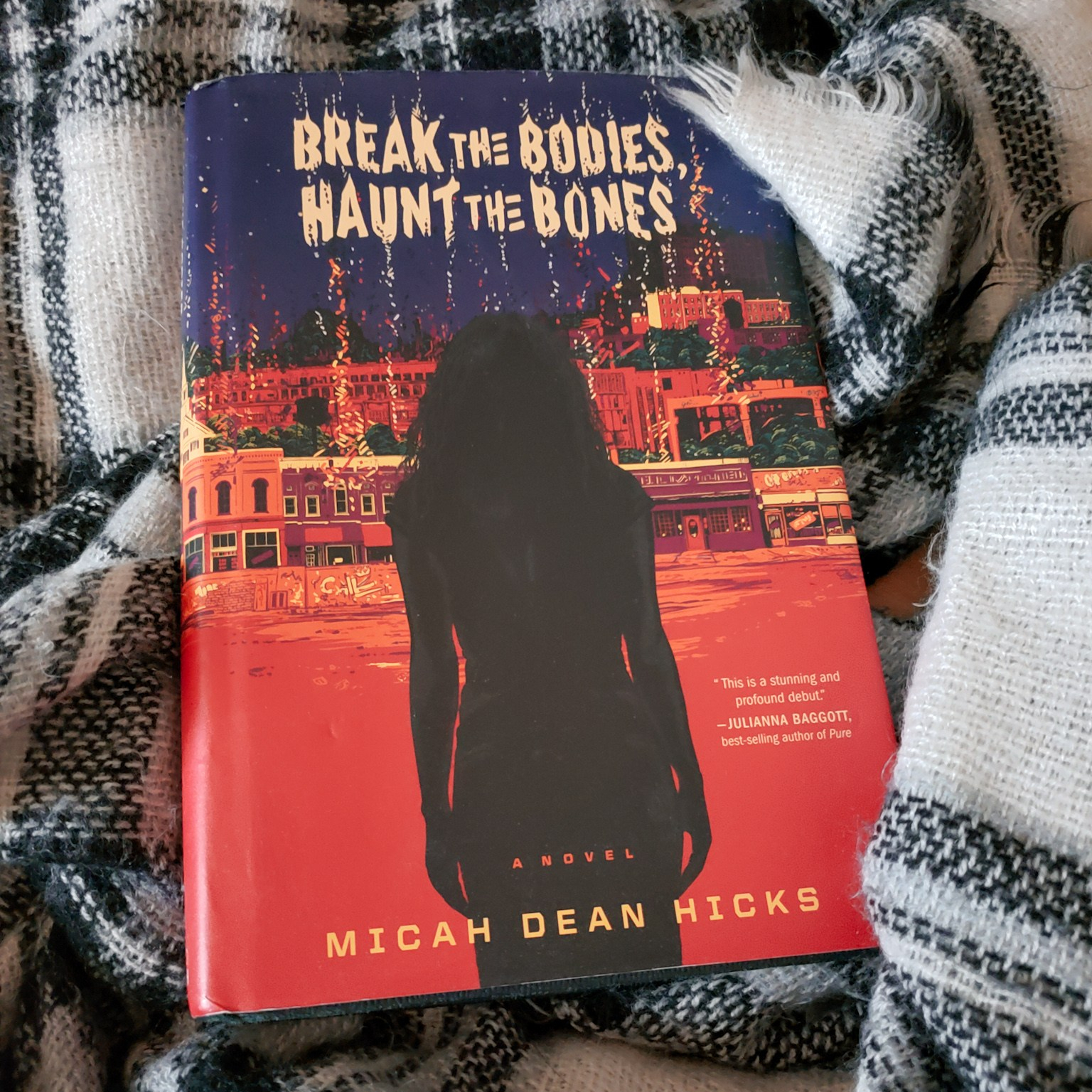 A photo of my copy of Break the Bodies, Haunt the Bones by Micah Dean Hicks.