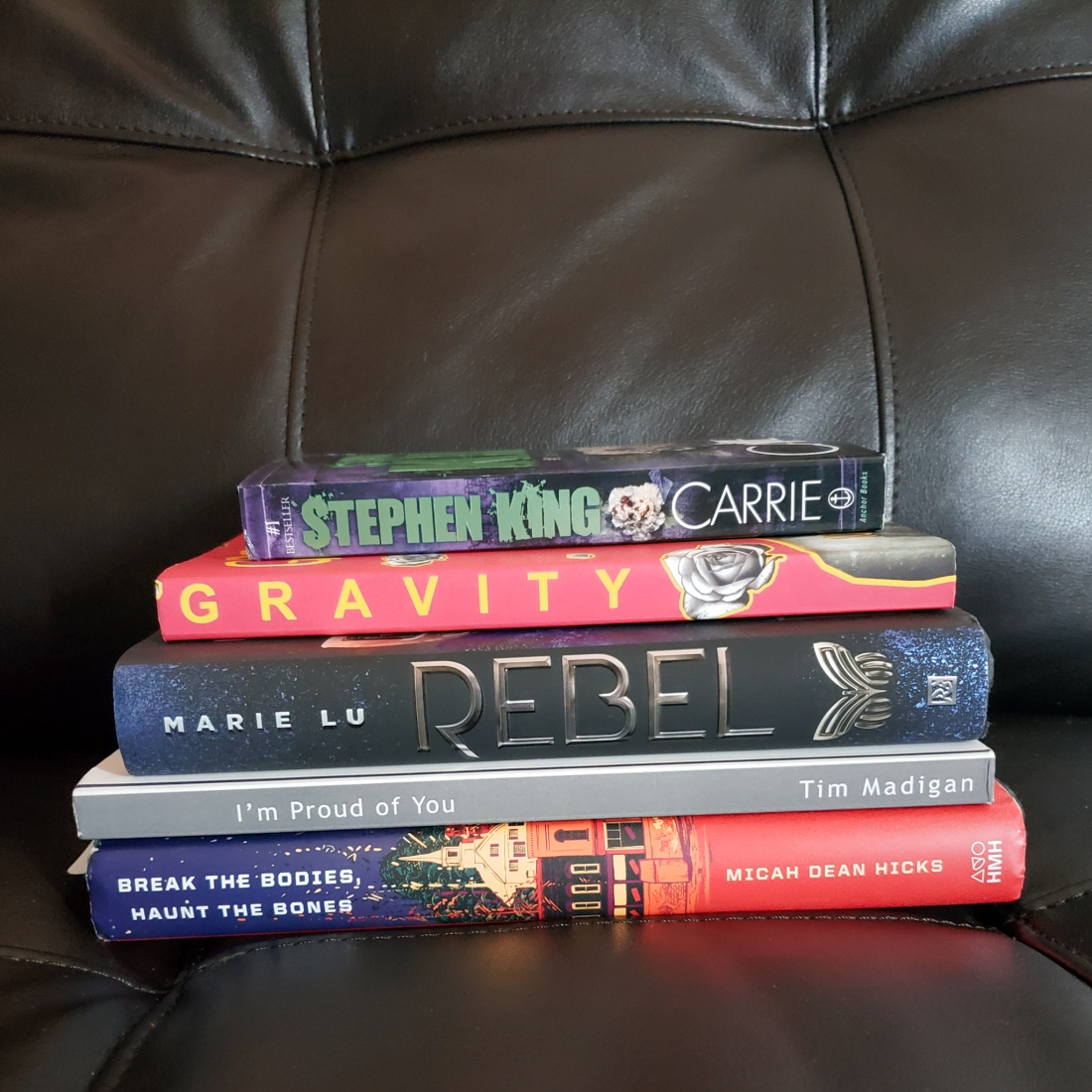 There are five books at the top of my reading list this month, and they are all stacked up right here.
