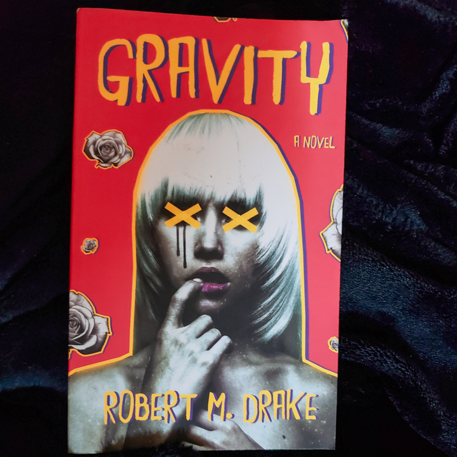 A photo of my friend's copy of Gravity by Robert M. Drake.