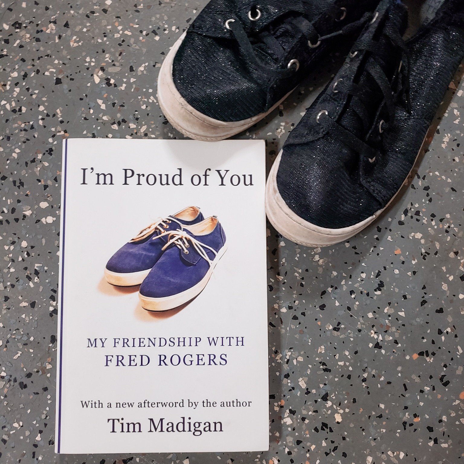 A photo of my copy of I'm Proud of You by Tim Madigan, featuring a pair of my shoes.