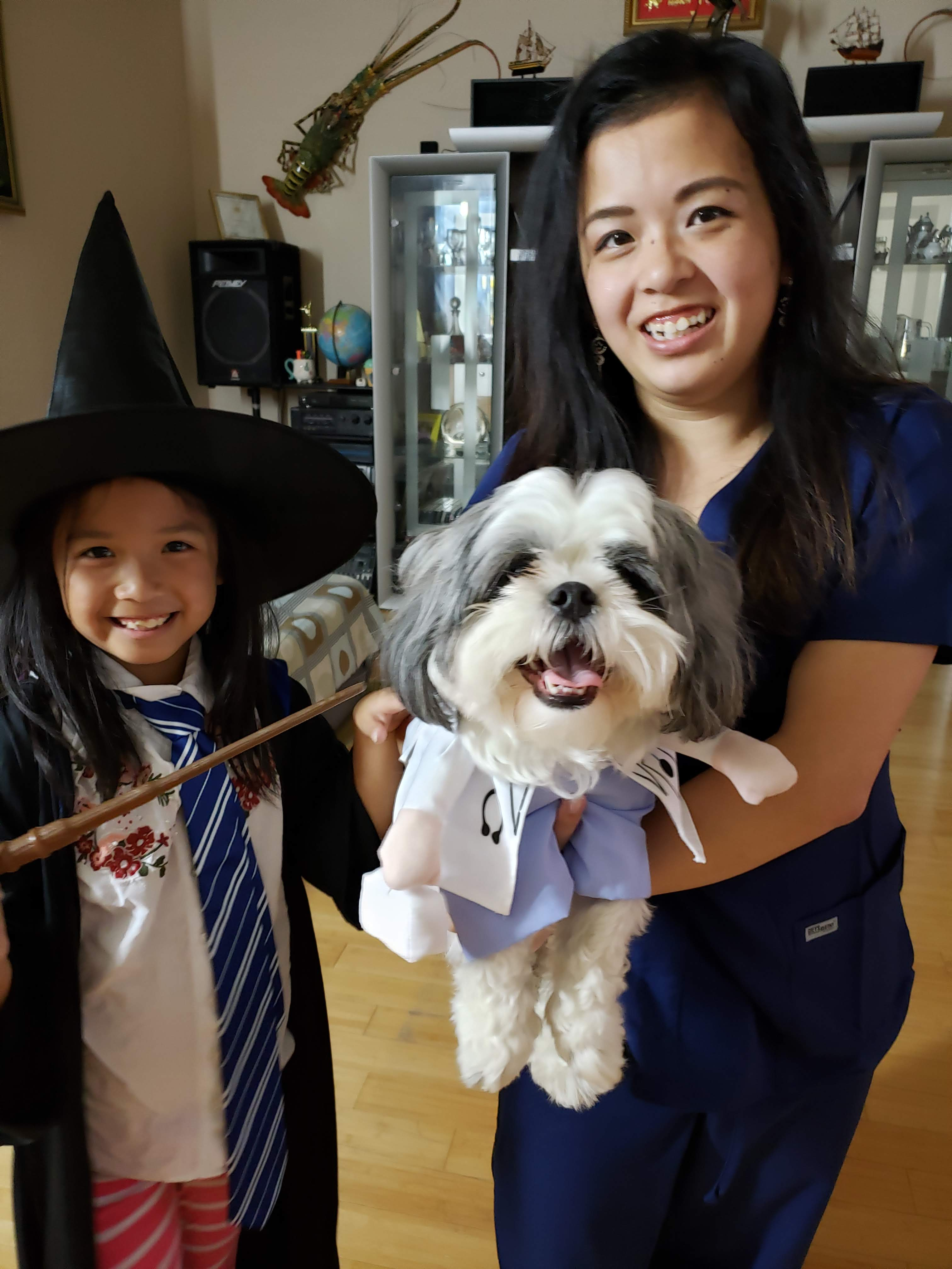Here is a photo of Damian, my dog, from Halloween last year. We dressed him up as a dog-tor, and I matched with him as a nurse. Kimmy matched us in color, as she went as a Ravenclaw.