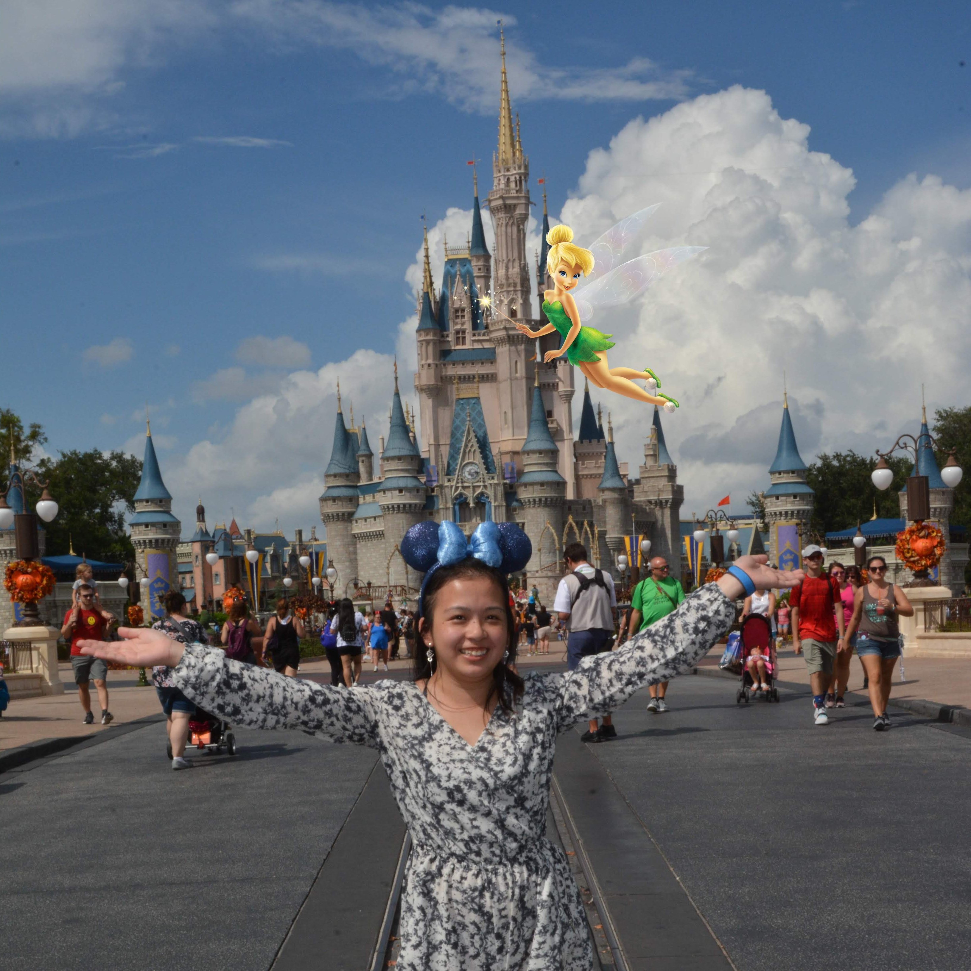 A photo of me and my mouse ears at Magic Kingdom. Tinker Bell is flying around spreading all the magical pixie dust.