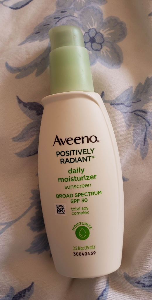 The Aveeno Positively Radiant bottle is small enough to fit in the palm of my hand. It's white with green accents, and it comes in a box so you might not see the bottle until you've purchased it and opened it up.