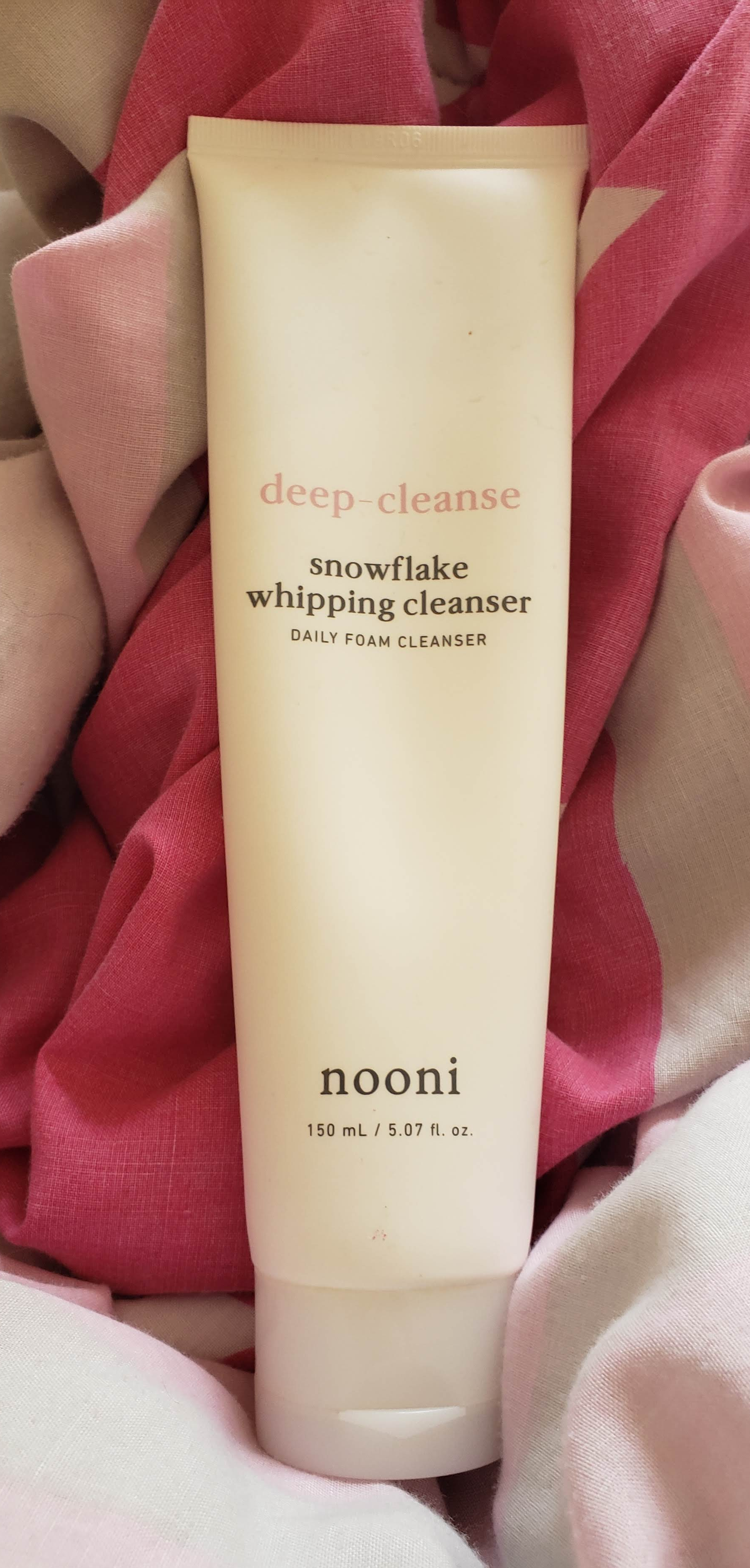 This is what the snowflake whipping cleanser looks like. It's very simple in white, with text to label exactly what the product is.