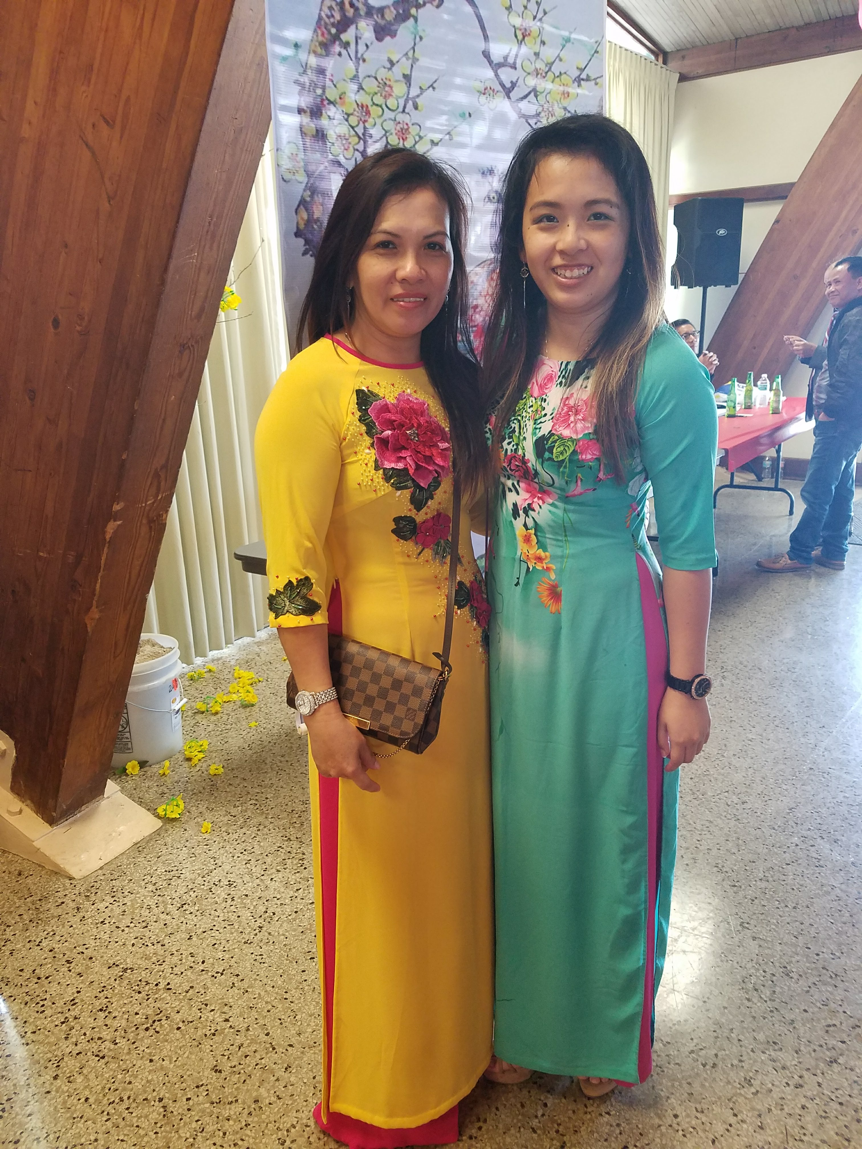 It's me and my mom in ao dais, the traditional Vietnamese dress for women.