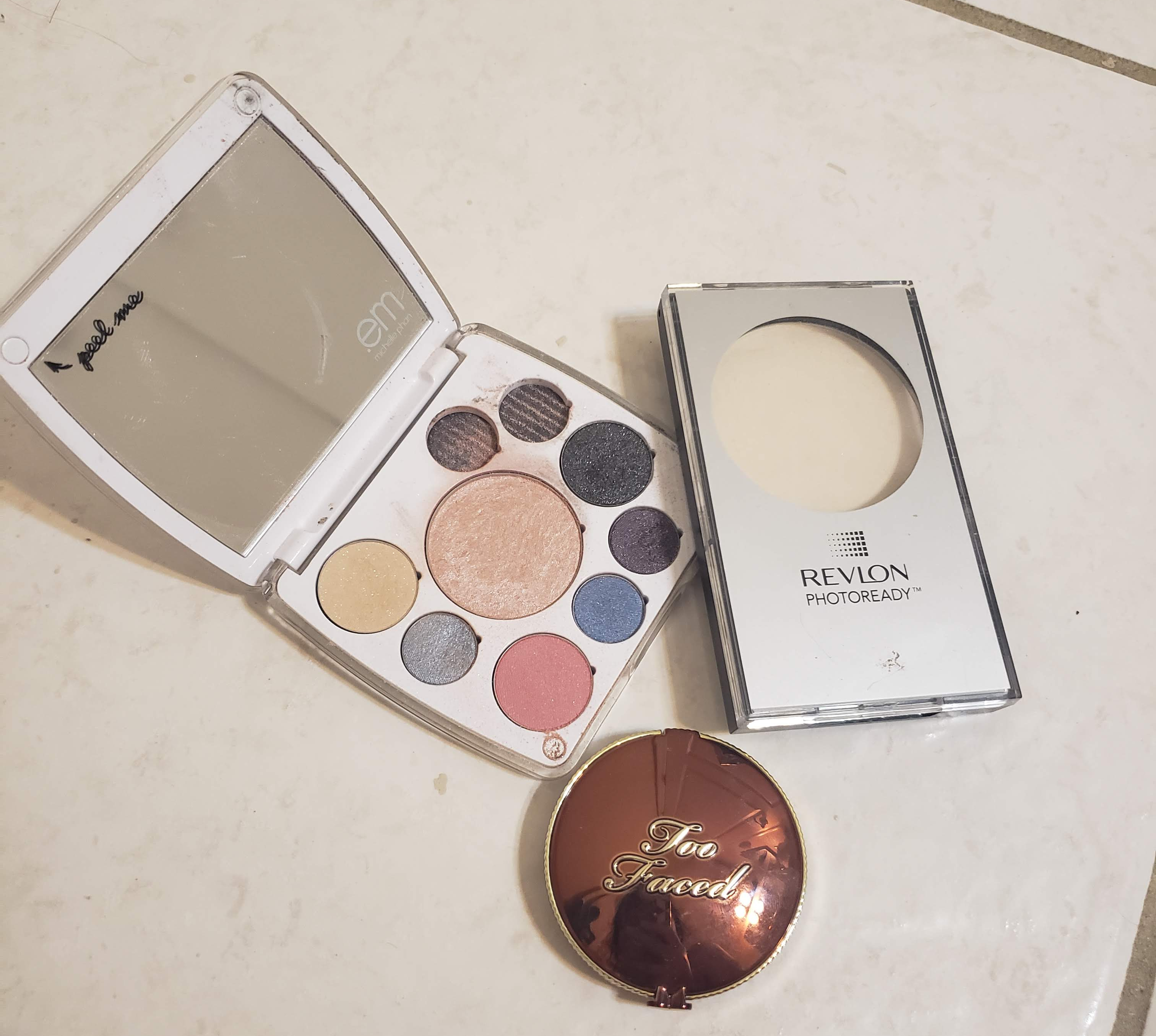 Pictured: A compact by EM Cosmetics, Revlon PhotoReady Translucent Finisher, and Too Faced Chocolate Soleil Bronzer.
