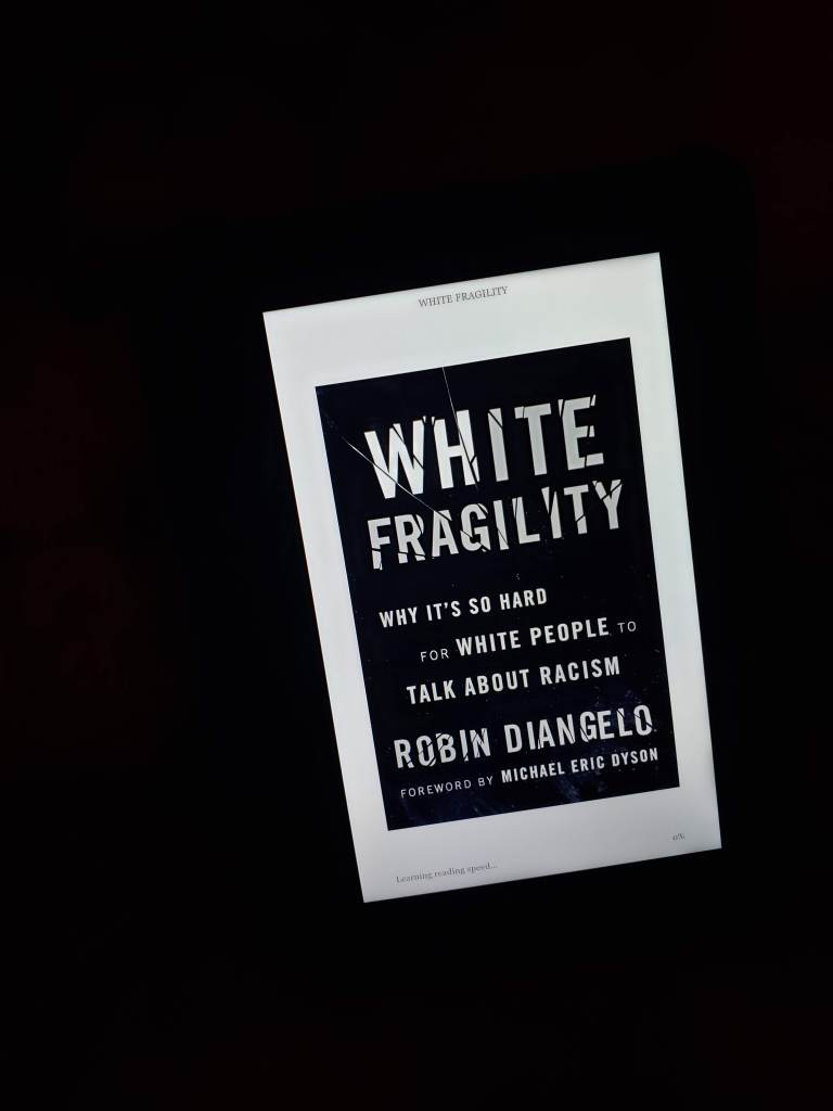 The physical copy might be on back order, but the benefit of buying White Fragility by Robin Diangelo on my Kindle is I can read in the dark.