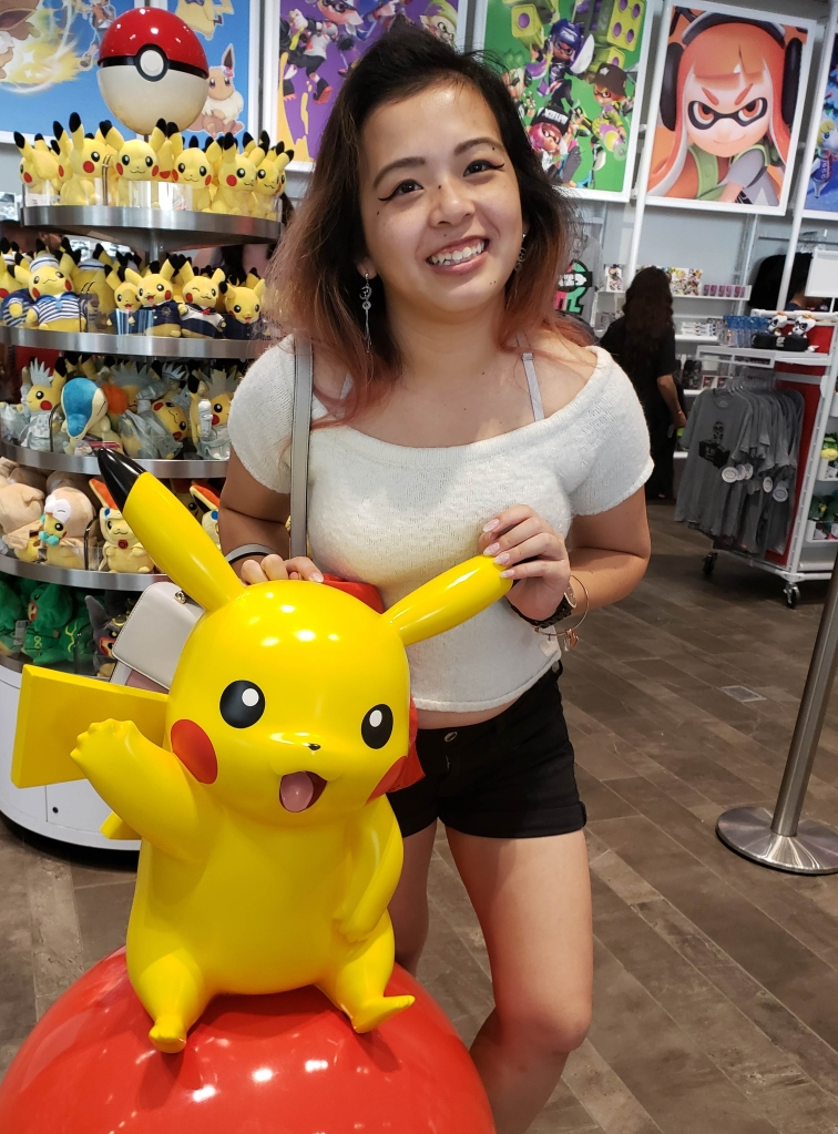 Here's a photo of me posing with a Pikachu statue in the Ninetendo Store in New York City.