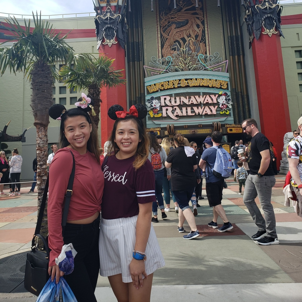Here's a photo of me and my sister in front of the Mickey and Minnie's Runaway Railway attraction before the world shut down.