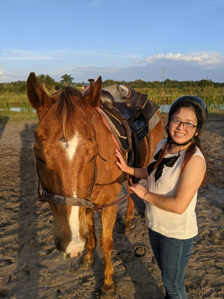 It's me and the horse I rode! I would like to think that his eyes are closed because he felt really at peace with me.